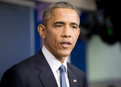 President Barack Obama speaks during a news conference in the Brady Press Briefing Room of the White House in Washington, Friday, Dec. 19, 2014. The president said the US is making significant strides where it counts, beginning with the economy. (AP Photo