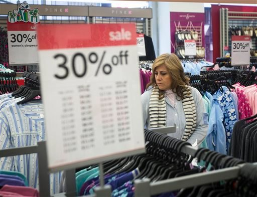 FILE - In this Thursday, Nov. 27, 2014 file photo, Giselle Basurto, of Mexico, shops at a Kmart store in New York on Thanksgiving Day. (AP)