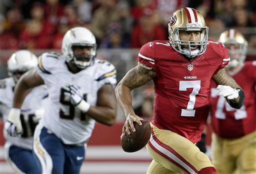 San Francisco 49ers quarterback Colin Kaepernick (7) runs against the San Diego Chargers during the first quarter of an NFL football game in Santa Clara, Calif., Saturday, Dec. 20, 2014.