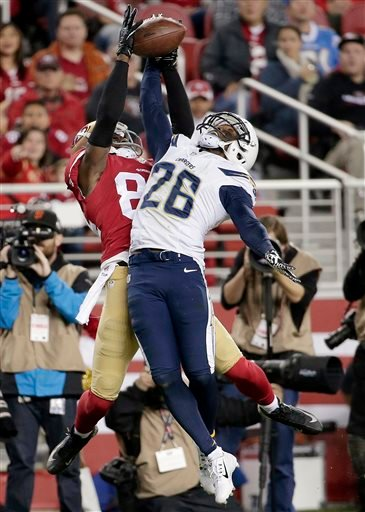 San Diego Chargers defensive back Brandon Flowers (26) breaks up a pass intended for San Francisco 49ers wide receiver Brandon Lloyd during the first quarter of an NFL football game in Santa Clara, Calif., Saturday, Dec. 20, 2014.