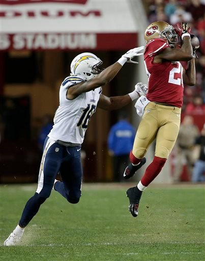San Francisco 49ers defensive back Perrish Cox, right, intercepts a pass intended for San Diego Chargers wide receiver Seyi Ajirotutu during the first quarter of an NFL football game in Santa Clara, Calif., Saturday, Dec. 20, 2014.