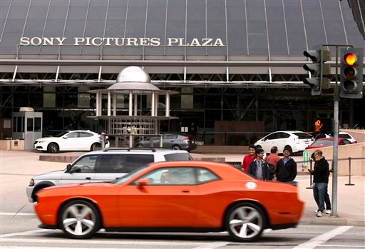 "Cars drive by the Sony Pictures Plaza building in Culver City, Calif., Friday, Dec. 19, 2014. President Barack Obama declared Friday that Sony ""made a mistake"" in shelving the satirical film, ""The Interview,"" about a plot to assassinate North Korea's lead"