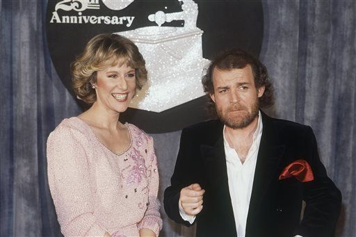 In this Feb. 23, 1983 file photo, Joe Cocker, right, and Jennifer Warnes appear at the 25th Grammy Awards in Los Angeles.