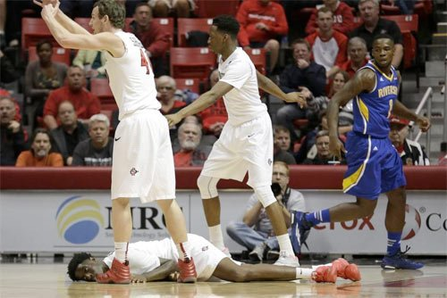 Dwayne Polee II lays on the court as his teammates call for paramedics during a scary moment during San Diego State's game against UC Riverside.