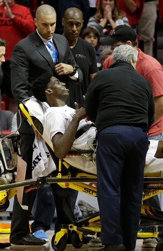 San Diego State forward Dwayne Polee II raises his hands as he is taken off the court on a stretcher after an injury while playing UC Riverside during the first half of an NCAA college basketball game Monday, Dec. 22, 2014, in San Diego.