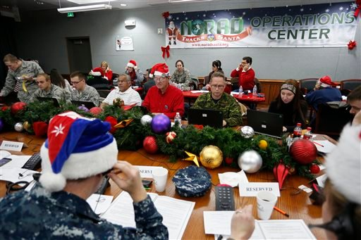 Volunteers take phone calls from children asking where Santa is and when he will deliver presents to their homes, inside a phone-in center during the annual NORAD Tracks Santa Operation, at the North American Aerospace Defense Command.