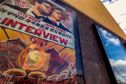 "This Wed., Dec. 17, 2014 photo shows a movie poster for the movie ""The Interview"" on display outside the AMC Glendora 12 movie theater, in Glendora, Calif. In an unprecedented move, Sony Pictures broadly released ""The Interview"" to digital platforms Wedne"