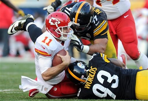 In this Dec. 21, 2014, file photo, Kansas City Chiefs quarterback Alex Smith (11) is sacked by Pittsburgh Steelers defensive end Cameron Heyward (97) and outside linebacker Jason Worilds (93) during the second half of an NFL football game in Pittsburgh. S