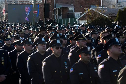 Police officers turn their backs as New York City Mayor Bill de Blasio speaks at the funeral of New York City police officer Rafael Ramos in the Glendale section of Queens, Saturday, Dec. 27, 2014, in New York. Ramos and his partner, officer Wenjian Liu,