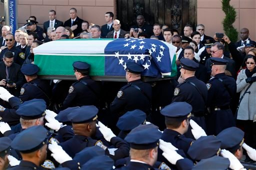 Pallbearers carry the casket of New York City police officer Rafael Ramos following funeral services at Christ Tabernacle Church, in the Glendale section of Queens, Saturday, Dec. 27, 2014, in New York. Ramos and his partner, officer Wenjian Liu, were kil
