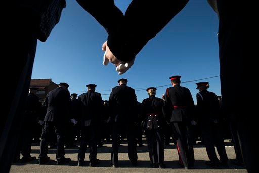 Police officers hold hands in prayer during the funeral service of New York City police officer Rafael Ramos in the Glendale section of Queens, Saturday, Dec. 27, 2014, in New York. Ramos and his partner, officer Wenjian Liu, were killed Dec. 20 as they s