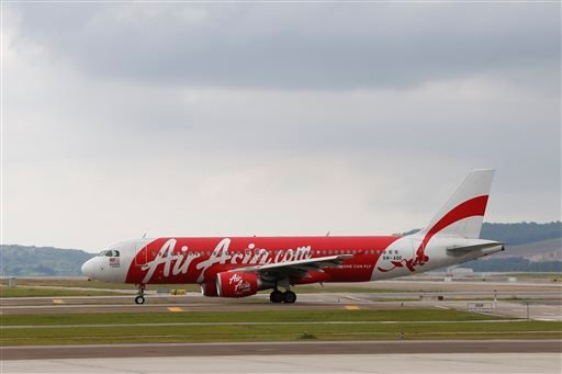 In this Nov. 26, 2014 photo, AirAsia Airbus A320-200 passenger jets are taxing on the tarmac at low cost terminal KLIA2 in Sepang, Malaysia. An AirAsia plane with 162 people on board lost contact with ground control on Sunday, Dec. 28, 2014, while flying