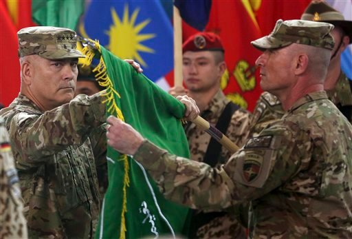 """Commander of the International Security Assistance Force (ISAF), Gen. John Campbell, left, and Command Sgt. Maj. Delbert Byers open the """"Resolute Support"""" flag during a ceremony at the ISAF headquarters in Kabul, Afghanistan, Sunday, Dec. 28, 2014. The Un"""