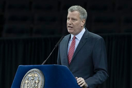 New York City Mayor Bill de Blasio speaks during a New York Police Academy graduation ceremony, Monday Dec. 29, 2014, at Madison Square Garden in New York. (AP)