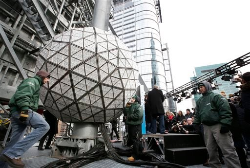 Workers prepare to test the Waterford crystal ball for the New Year's Eve celebration atop One Times Square in New York, Tuesday, Dec. 30, 2014. (AP)