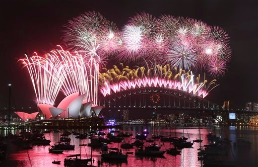 Fireworks explode over the Opera House and the Harbour Bridge during New Years Eve celebrations in Sydney, Australia, Thursday, Jan. 1, 2015. (AP Photo/Rob Griffith)