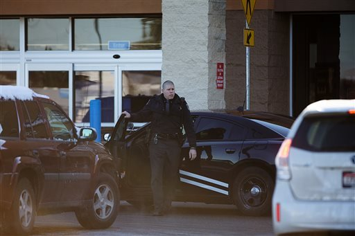 An Idaho State Patrol officer arrives at Wal-Mart in Hayden, Idaho, Tuesday, Dec. 30, 2014. (AP Photo/Coeur d'Alene Press, Tess Freeman)