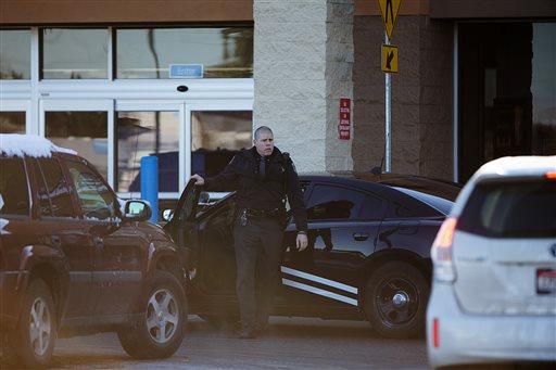 An Idaho State Patrol officer arrives at Wal-Mart in Hayden, Idaho, Tuesday, Dec. 30, 2014. (AP Photo/Coeur d'Alene Press, Tess Freeman)