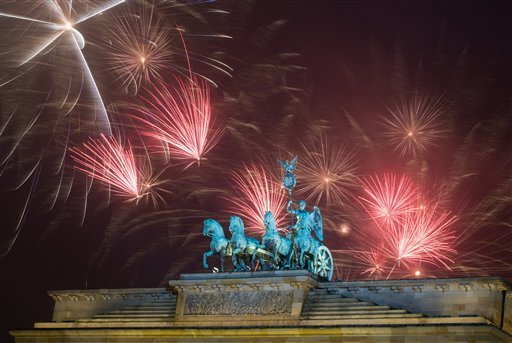 Fireworks explode during the New Year's party at Brandenburg Gate in Berlin, Thursday, Jan. 1, 2015. (AP Photo/dpa, Lukas Schulze)