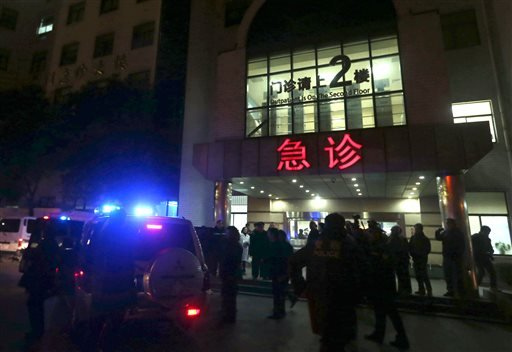 In this photo released by China's Xinhua News Agency, medical workers stand outside the emergency ward of the No. 1 People's Hospital of Shanghai after a stampede caused casualties among people who took part in New Year's celebrations. (AP)