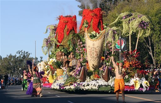 """The Dole Packaged Foods float, """"Rhythm Of Hawaii,"""" winner of the Sweepstakes trophy, moves down Colorado Boulevard in the 126th Rose Parade in Pasadena, Calif., Thursday, Jan. 1, 2015. (AP Photo/Ringo H.W. Chiu)"""