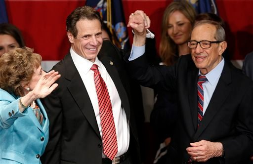 In this Nov. 4, 2014, file photo, Democratic New York Gov. Andrew Cuomo, second from left, celebrates with his father, former New York Gov. Mario Cuomo, and his mother, Matilda, left, after defeating Republican challenger Rob Astorino, at Democratic elect
