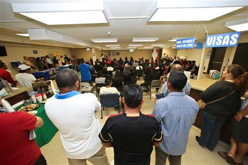 In this April 23, 2014, file photo, a crowd of approximately 80 immigrants fill a room as they listen to officials explain the process of getting a drivers license, during an information session at the Mexican Consulate, in San Diego. California is gearin