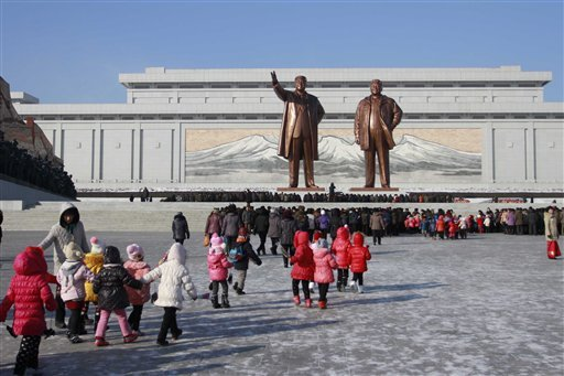 In thus Dec. 16, 2014 file photo, North Koreans gather at the Mansu Hill where the statues of the late leaders Kim Il Sung, and Kim Jong Il tower over them, in Pyongyang, North Korea.