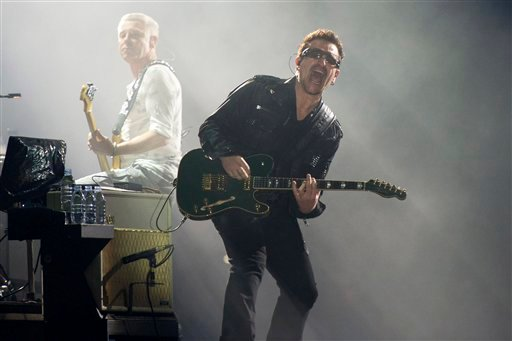 In this July 20, 2011 file photo, Bono, right, and Adam Clayton, from the rock group U2, perform in concert as part of U2's 360 Tour at the New Meadowlands Stadium in East Rutherford, N.J.