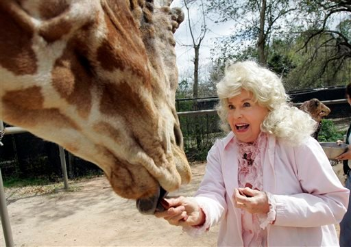 """In this March 4, 2009 file photo, Donna Douglas, who starred in the television series """"The Beverly Hillbillies"""" tours the Audubon Zoo in New Orleans."""