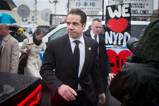 New York Gov. Andrew Cuomo leaves the wake of New York Police Department officer Wenjian Liu at the Aievoli Funeral Home, Saturday, Jan. 3, 2015, in the Brooklyn borough of New York. Liu and his partner, officer Rafael Ramos, were killed Dec. 20 as they s