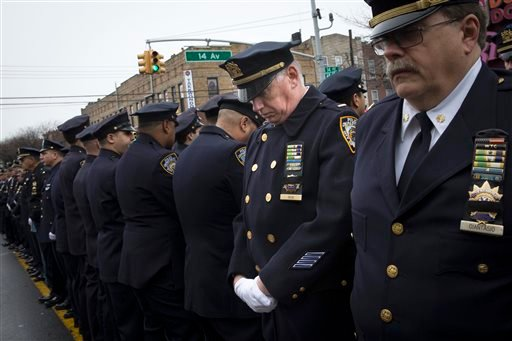 Some police officers turn their backs as Mayor Bill de Blasio speaks during the funeral of New York Police Department Officer Wenjian Liu at Aievoli Funeral Home, Sunday, Jan. 4, 2015, in the Brooklyn borough of New York. Liu and his partner, officer Rafa