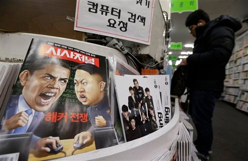 A magazine with cartoons of U.S. President Barack Obama, left, and North Korean leader Kim Jong Un is displayed at a book store in Seoul, South Korea, Saturday, Jan. 3, 2015. The United States imposed new sanctions Friday on North Korean government offici