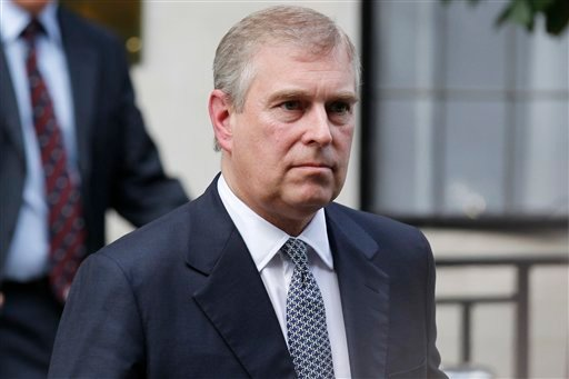 In this Wednesday, June 6, 2012 file photo, Britain's Prince Andrew leaves King Edward VII hospital in London after visiting his father Prince Philip. Reacting to U.S. court documents, royal officials issued a statement on Friday, Jan. 2, 2015 denying th
