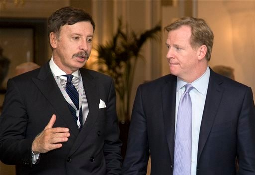 In this Oct. 8, 2013, file photo, Stan Kroenke, owner of the St. Louis Rams football team, left, talks with NFL Commissioner Roger Goodell during a break in the NFL fall meeting in Washington.