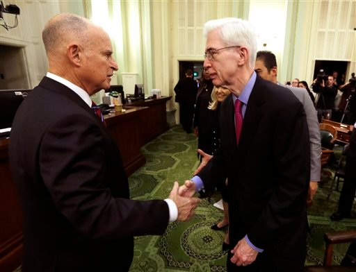 California Gov. Jerry Brown, left, is greeted by former Gov. Gray Davis, right, after his inauguration at the state Capitol Monday, Jan. 5, 2015, in Sacramento, Calif. (AP)