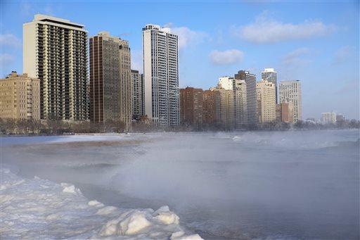 Waves splash as blocks of ice pile up along Lake Michigan near Oak Street Beach, Monday, Jan. 5, 2015, in Chicago. (AP)