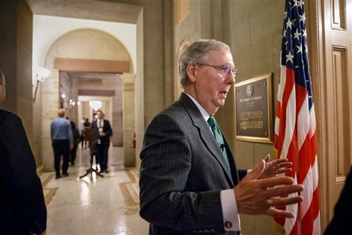 Incoming Senate Majority Leader Mitch McConnell of Ky. pauses outside his office on Capitol Hill in Washington, Monday, Jan. 5, 2015, as he prepares for Tuesday's opening of the 114th Congress under GOP control. (AP Photo/J. Scott Applewhite)