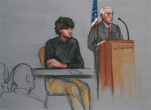 In this courtroom sketch, Boston Marathon bombing suspect Dzhokhar Tsarnaev, left, is depicted beside U.S. District Judge George O'Toole Jr., right, as O'Toole addresses a pool of potential jurors in a jury assembly room at the federal courthouse Monday,