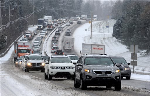 Traffic is snarled on Route 202 northbound at Street Road in West Chester, Pa., as an Alberta Clipper sweeps through the area dumping up to two inches of snow Tuesday, Jan. 6, 2015. (AP Photo /The Philadelphia Inquirer, Clem Murray)