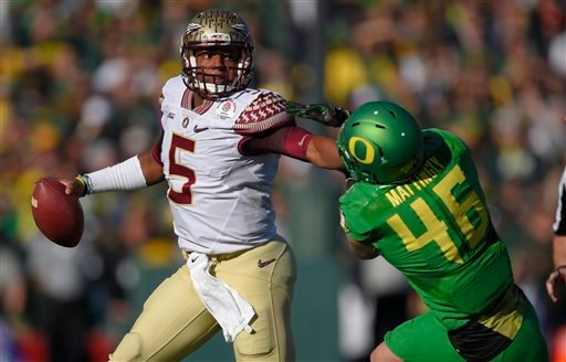 Florida State quarterback Jameis Winston, left, looks to pass under pressure from Oregon linebacker Danny Mattingly during the first half of the Rose Bowl NCAA college football playoff semifinal, Thursday, Jan. 1, 2015, in Pasadena, Calif. (AP)