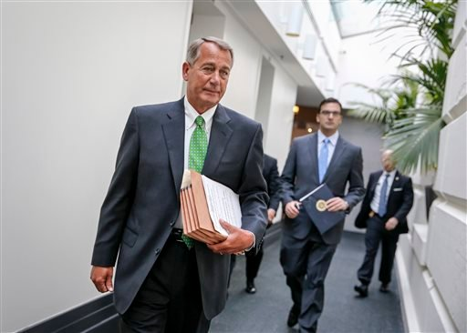 House Speaker John Boehner of Ohio walks to a closed-door meeting with House Republicans, Wednesday, Jan. 7, 2015, on Capitol Hill in Washington. (AP Photo/J. Scott Applewhite)