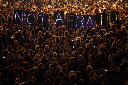 People gather in solidarity of the victims of a terror attack against a satirical newspaper, in Paris, Wednesday, Jan. 7, 2015. (AP)