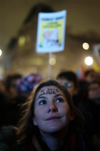 "The inscription ""I am Charlie"" is written on the fronthead of a woman as she attends a gathering to pay respect for the victims of a terror attack against a satirical newspaper, in Paris, in Paris, Wednesday, Jan. 7, 2015. (AP)"