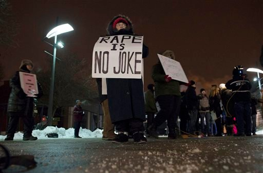 Protestors gather outside the Centre in the Square theater in Kitchener, Ontario, Canada on Wednesday, Jan. 7, 2015 to protest Bill Cosby amid brewing tensions and mounting allegations of sexual assault. (AP Photo/The Canadian Press, Hannah Yoon)