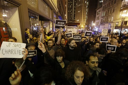 A crowd holds signs reading I am Charlie in French at a gathering in solidarity with those killed in an attack at the Paris offices of the weekly newspaper Charlie Hebdo outside of the French Consulate in San Francisco. (AP Photo/Marcio Jose Sanchez)