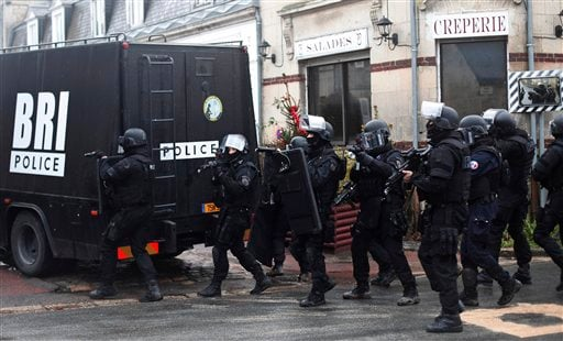 French riot officers patrol in Longpont, north of Paris, France, Thursday, Jan. 8, 2015. (AP)