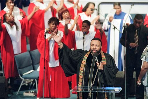 FILE - In this Sept. 1, 1996 file photo, Grammy winning gospel singer Andrae Crouch sings during service at the Christ Memorial church in Pacoima, Calif. (AP)