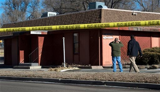 Colorado Springs police officers investigate the scene of an explosion Tuesday, Jan. 6, 2015, at a building in Colorado Springs, Colo. (AP)