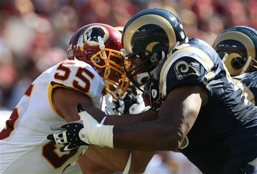 In this Oct. 12, 2008, file photo, St. Louis Rams offensive tackle Orlando Pace, right, blocks Washington Redskins defensive end Jason Taylor during an NFL football game in Landover, Md.